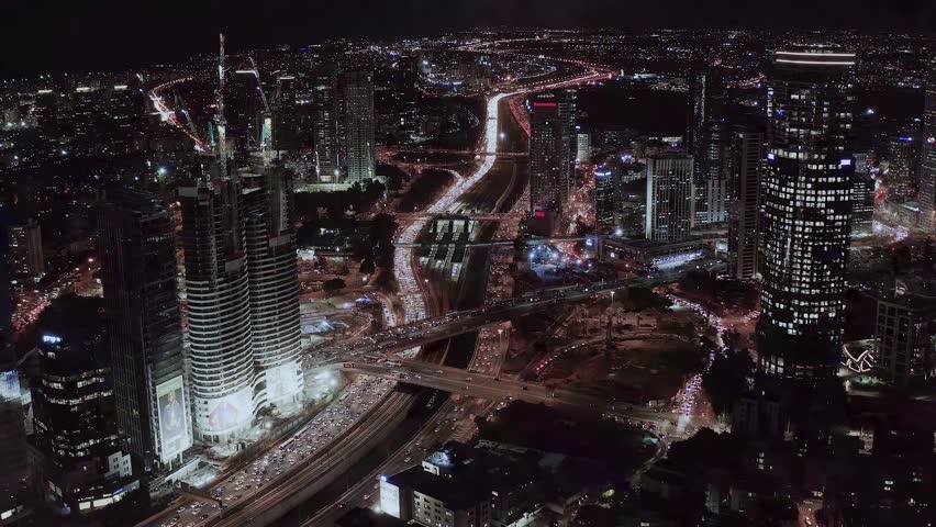 Night view on Tel Aviv bursa, aerial 4k | Shutterstock HD Video #1020291319