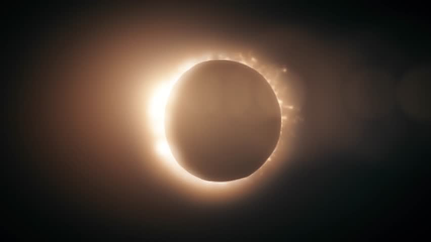 Abstract full solar eclipse on scientific black background. The Moon mostly covers the visible Sun creating a golden diamond ring effect.   Shutterstock HD Video #1020296056