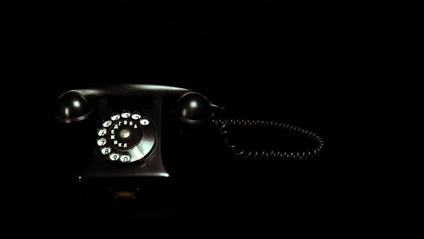 Old phone on the black table | Shutterstock HD Video #1020314629