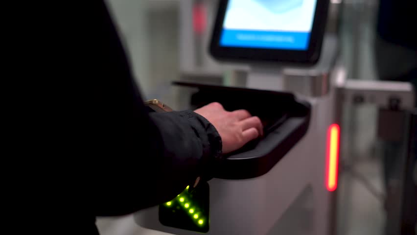 Passenger At Automated Customs Clearance Scanning passport In Airport.
