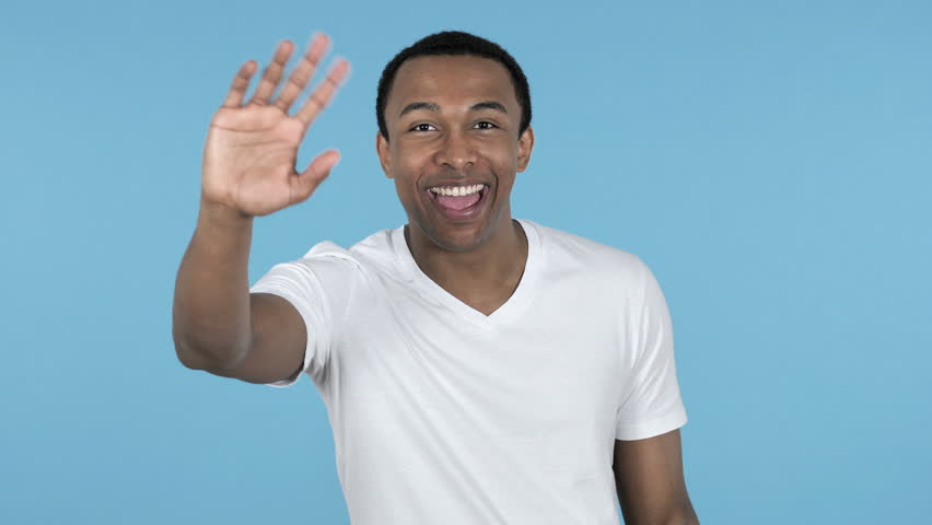Online Video Chat by Young African Man isolated on Blue Background | Shutterstock HD Video #1020341566