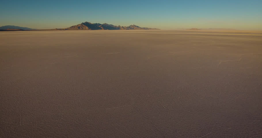 An aerial flyover of the Bonneville Salt Flats at sunset outside of Salt Lake City in western Utah.