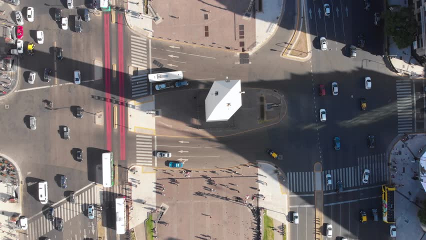 Aerial drone view of Buenos Aires obelisk on avenida de Julio in Buenos aires.  Looking down on obelisco and street traffic with cars. Argentina. #1020370477