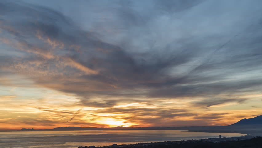 Spectacular sunset timelapse in Marbella, Costa del Sol Malaga Spain. Incredible changing colours in the golden hour.Unbelievable view of the sky from the top of the mountains. | Shutterstock HD Video #1020382045