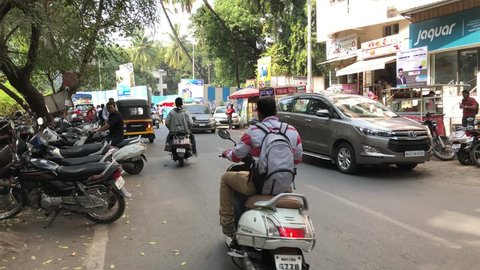 Pune, India – December 03 2018: A street scene including traffic at Pune India.