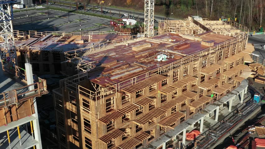 Building under construction. The site with crane. Drone flying. 4k. | Shutterstock HD Video #1020404014