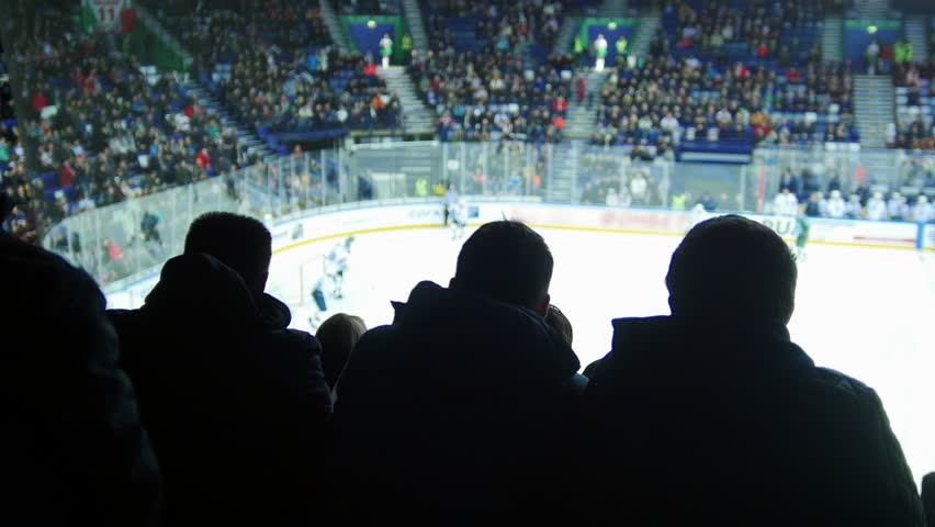 A group of young people watching hockey match | Shutterstock HD Video #1020405808