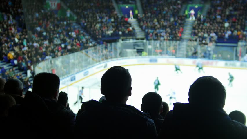 A group of silhouettes of young people watching hockey match | Shutterstock HD Video #1020405868
