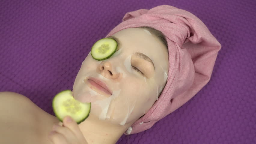 Closeup view of young beautiful girl gets beauty treatments. Relax and spa concept at home.    Shutterstock HD Video #1020419812