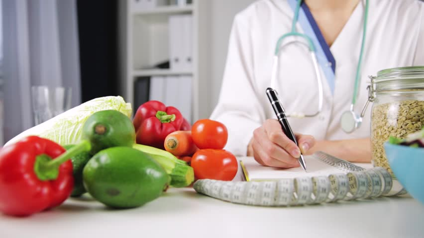 Vegetable diet nutrition and medication concept. Nutritionist offers healthy vegetables diet.