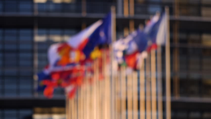Defocused cinematic slow motion over all flags of European Union member states on a warm sunny day in front of European parliament news Royalty-Free Stock Footage #1020457915