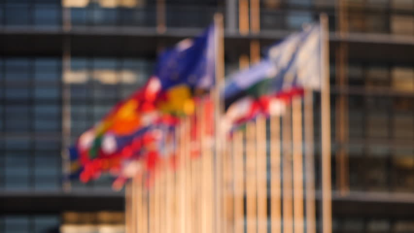 Defocused cinematic slow motion over all flags of European Union member states on a warm sunny day in front of European parliament Royalty-Free Stock Footage #1020457930
