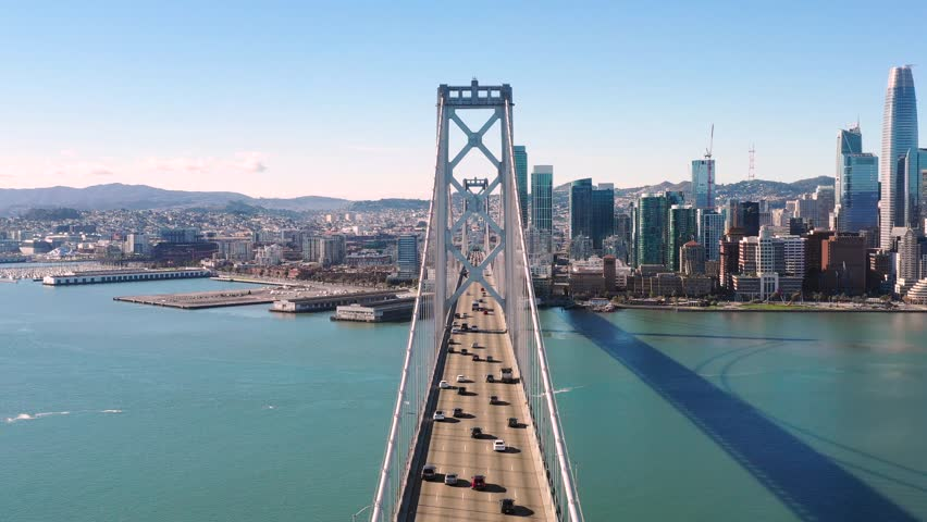 Cars Driving into San Francisco over the Bay Bridge on a clear day  | Shutterstock HD Video #1020461515