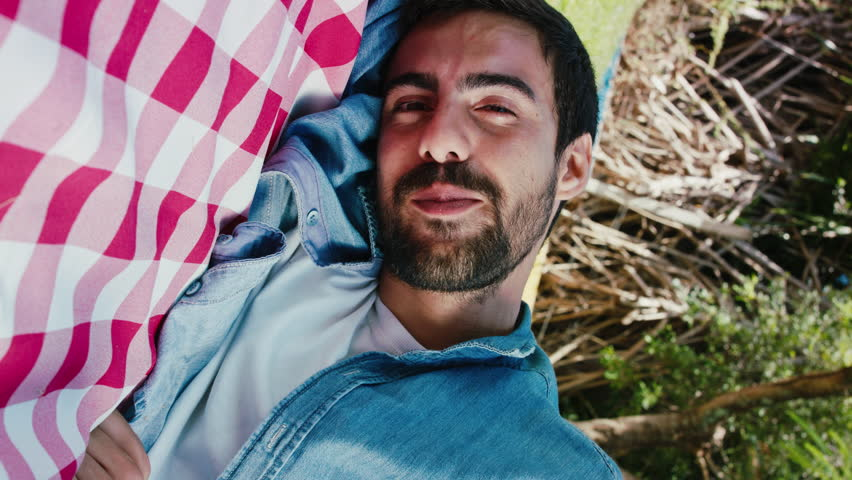 Handsome Man Lying On Grass Touching Camera Point Of View With Affection | Shutterstock HD Video #1020479170