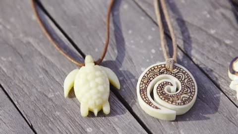 Bone Carved Pendants Slide Over Stock Footage Video 100 Royalty Free 15587341 Shutterstock