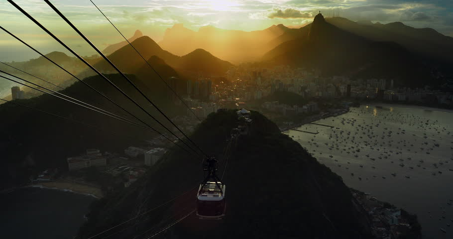 Rio de Janeiro, Brazil, view of Rio cityscape and Sugarloaf Cable Car at sunset. | Shutterstock HD Video #1020495247