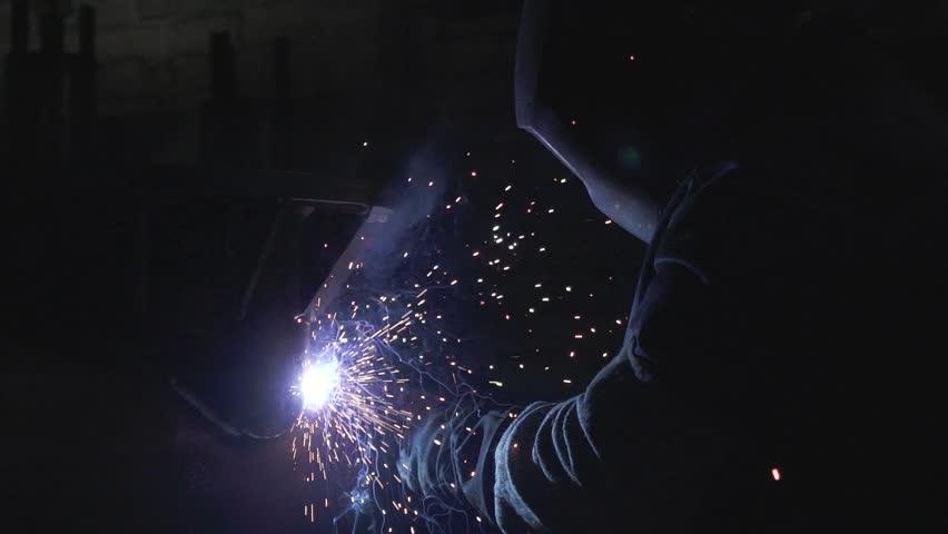 Professional Industrial worker welding at workshop in slow motion | Shutterstock HD Video #1020501808