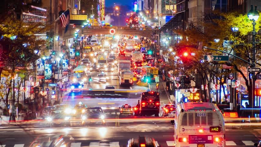 NEW YORK CITY - NOVEMBER 2016: Pedestrians crossing 42nd street and night city traffic in New York City, USA