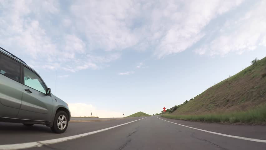 Driving on paved road in Boulder area. | Shutterstock HD Video #1020513946
