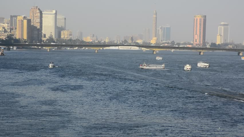 Nile river in Cairo Egypt during the day with boats running and high building surrounding river banks   Shutterstock HD Video #1020533629