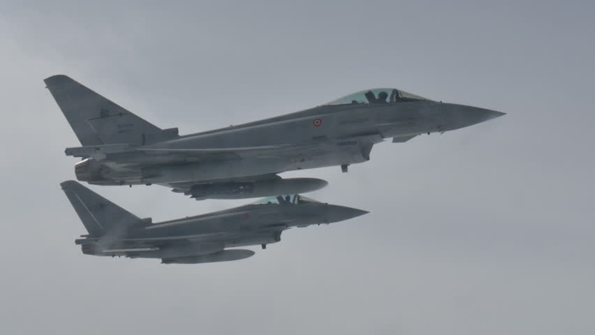 Military Fighter Combat Jet Aircrafts Formation Eurofighter Air to Air in Flight. Mediterranean Sea 9 June 2016