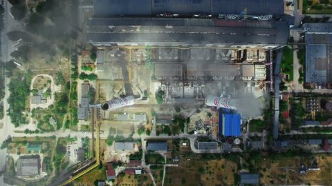 Manufacturing park with industrial and commercial constructions. Aerial view of industry zone with petrochemical factory. Dirty smoke coming out of chimney. Heavy industry production