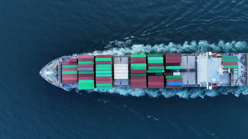 Aerial top view of cargo container ship vessel import export container in the ocean. | Shutterstock HD Video #1020556129