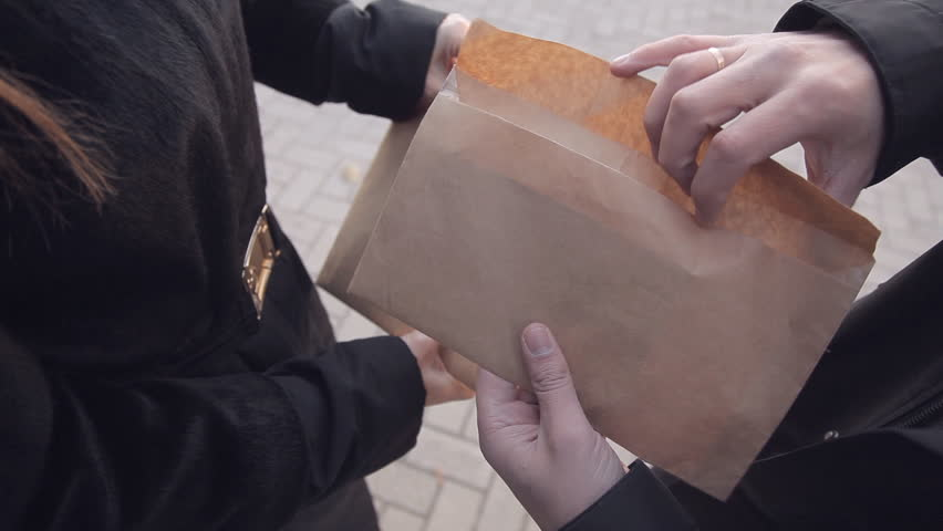 Clouse-up male spy sends secret documents to the woman, instead of receiving the envelope with money. Industrial espionage. The work of foreign agents Royalty-Free Stock Footage #1020566635
