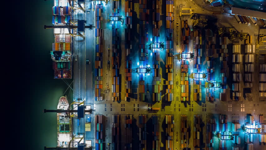 Aerial view drone time-lapse or hyper-lapse over industrial port in Bangkok Thailand with many container vessel ship and big crane working at night. | Shutterstock HD Video #1020573295