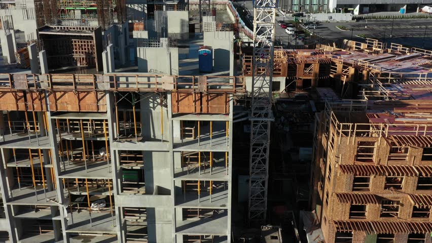 Building under construction. The site with crane. Aerial flying. 4k. | Shutterstock HD Video #1020574339