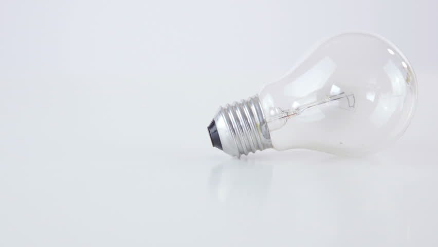 Two light bulbs on whte background HD. Dolly sliding over two traditional light bulbs, Edison light and newest halogen bulb. | Shutterstock HD Video #1020601306
