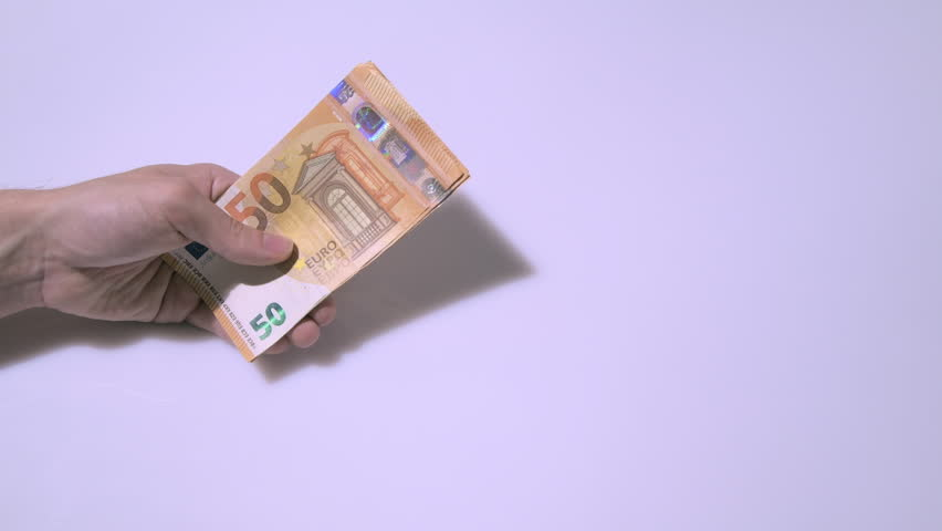 Euro banknotes on table. European money. Unique currency concept. Cash | Shutterstock HD Video #1020611356