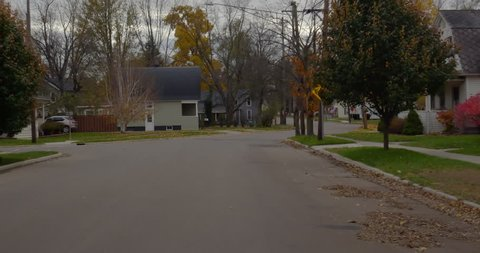 MILAN, MI, NOV 2018: Driving plate: front view 2 of 2. Mid West small town 50s neighborhood, autumn. 24mm lens 4/3in sensor. Part of 5-angle set. Composite: https://vimeo.com/304875590