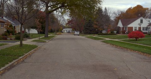 MILAN, MI, NOV 2018: Driving plate: rear view 1 of 2. Mid West small town 50s neighborhood, autumn. 24mm lens 4/3in sensor. Part of 5-angle set. Composite: https://vimeo.com/304875590