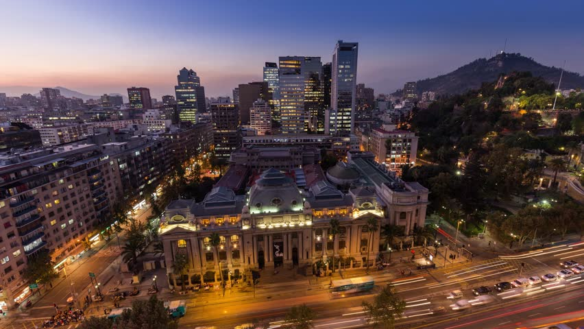 Day to night sunset timelapse hyperlapse of the historic national library of Santiago Chile in city downtown near Santa Lucia. Biblioteca Nacional de Chile. Skyscraper building in background. | Shutterstock HD Video #1020640744