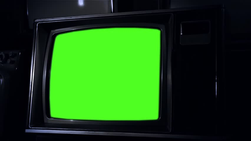 1980s Television with Green Screen. Night Tone. Zoom In. Ready to replace green screen with any footage or picture you want. | Shutterstock HD Video #1020642994