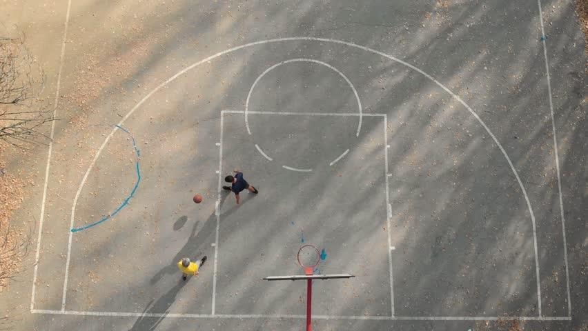 Father and son playing basketball in the park aerial view #1020754975