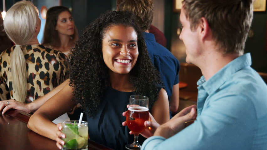 Young Couple On Date Meeting For Drinks In Cocktail Bar | Shutterstock HD Video #1020765316