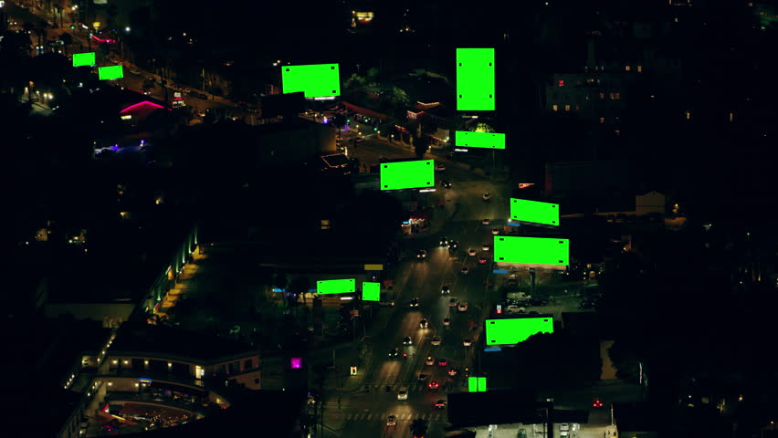 Green screen with track points aerial view of city traffic and billboards on Sunset Boulevard on a clear night in Los Angeles, California. Shot on 4K RED camera.