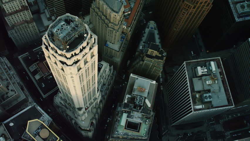 Shot on 4k RED camera on helicopter. Top down aerial view of tall buildings and city streets in New York City.