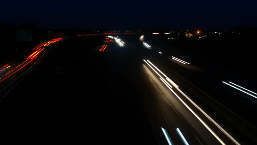 Busy time lapse traffic at night.  Seamless loop for use as a background | Shutterstock HD Video #1020787357