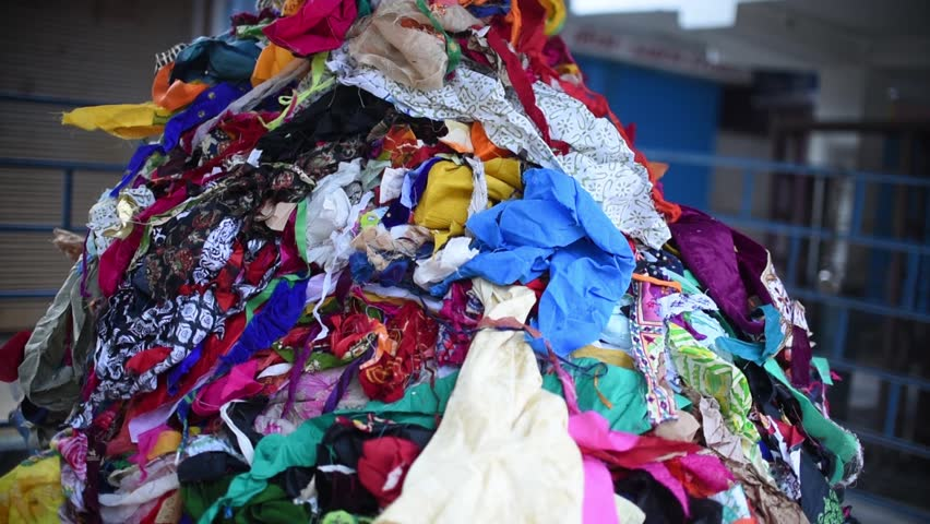 A pile of waste clothes thrown in trash, it could be used in recycling and given to poor Royalty-Free Stock Footage #1020816226