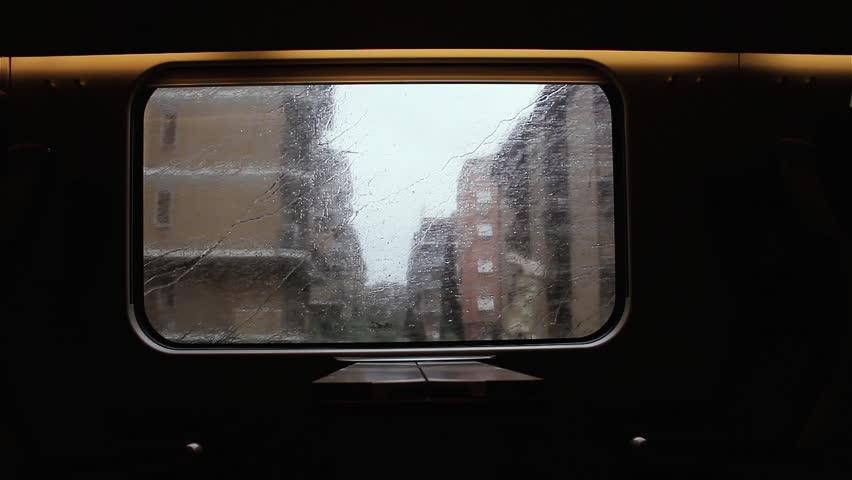 Landscape Through Moving Train Window with Rain.