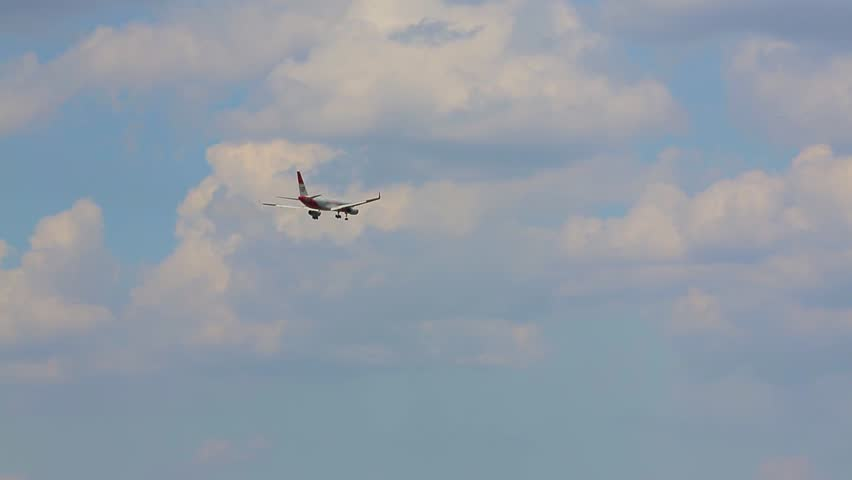 Flight of the plane in the clouds and over the fields   Shutterstock HD Video #1020834307