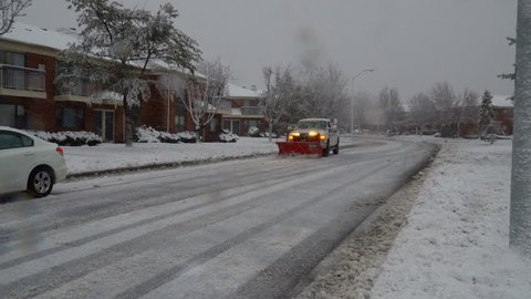 NY USA January 13, 2018: Snow-removing machine cleans the street from the snow