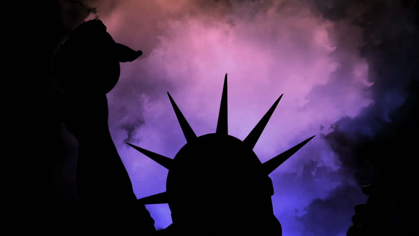 The statue of liberty of New York City against time lapse clouds   Shutterstock HD Video #1020902383