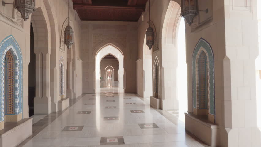Beautiful arched passageway at the Sultan Qaboos Grand Mosque in Muscat, Oman. Wonderful interior of the Muslim place. Amazing Islamic architecture.