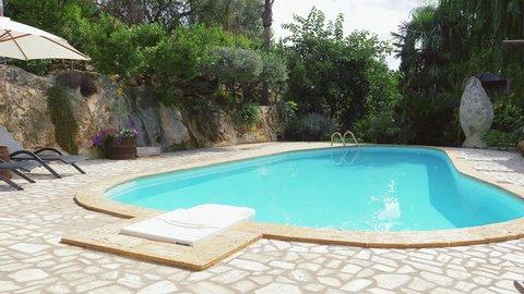Pan on swimming pool in resort slow motion