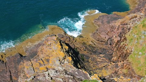 Aerial footage of waves crushing on the rocks on the Brittany coastline close to Cap Frehel in North of France.