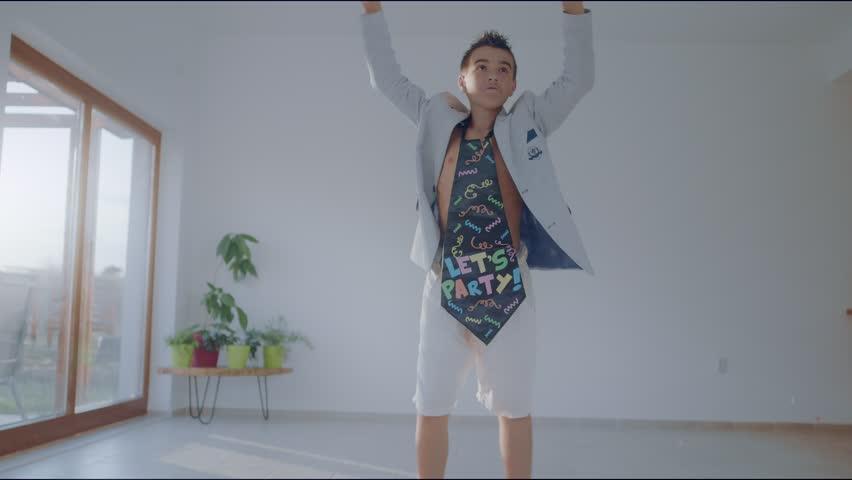Young boy dancing funny to disco music | Shutterstock HD Video #1020941644